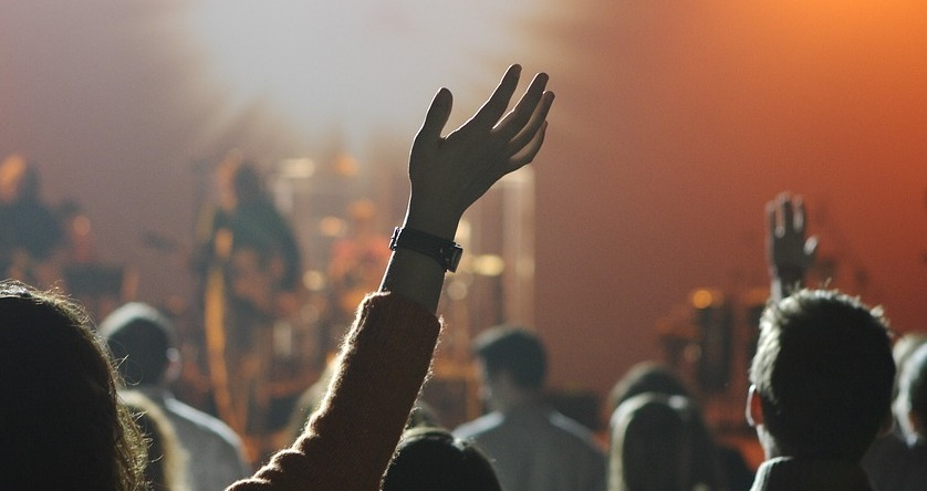 Hands raised at a live concert