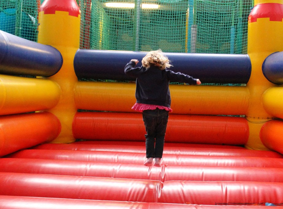 Girl playing in an inflatable playground